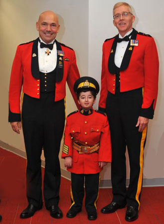 Photograph of RCMP Commissioner Bob Paulson, Casey Wright and Supt. Dave Critchley (OIC Burnaby Detachment) (Source of photo - Linda Wright)