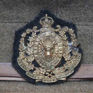 "Photograph of a RNWMP cap badge and CEF forage cap worn by a member of ""A"" Squadron RNWMP (Source of photo - Sheldon Boles)"