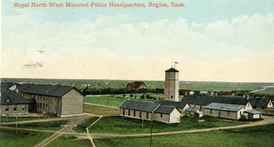 Photograph of RNWMP Headquarters with A Block in the centre of the photo and the chapel on the right.  (Source of photo - Ric Hall's Photo Collection)