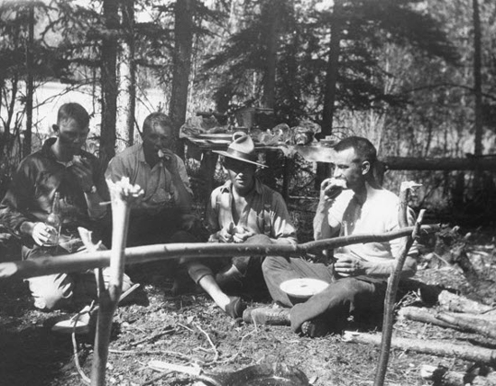 Photograph of RNWMP members having a meal on the trail (Source of photo - Ric Hall's Photo Collection).