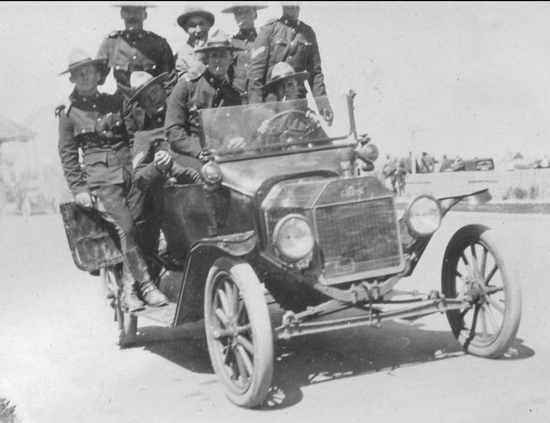 Photograph of RNWMP members trying out the new Ford horseless carriage (Source of photo - Ric Hall's Photo Collection).