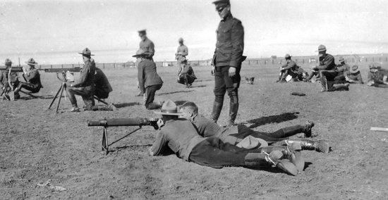 "Photograph of RNWMP members on the ""Depot"" barrack range receiving instruction on machine guns (Source of photo - Ric Hall's Photo Collection)."