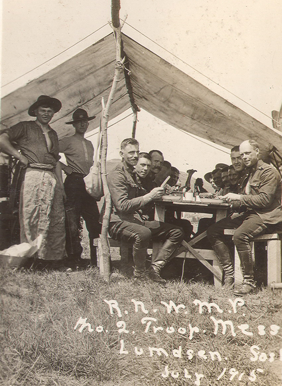 1915 - Photograph of RNWMP enjoying an outdoor meal in Lumsden Saskatchewan (Source of photo - Ric Hall's Photo Collection).