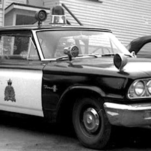 Photograph of an early 1960s RCMP marked police car. (Source of photo - Ric Hall's Photo Collection).
