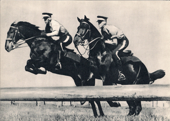 Photograph of two RCMP recruits demonstrating their acquired horsemanship skills (Source of photo - Ric Hall's Photo Corner).