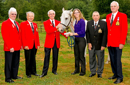 Photograph (left to right): Vice President Dick Hawkshaw, Director Ron Budd, President Keith Leishman, the horse Dodger which the Division provides financial support, PRDA Executive Director Michelle Meacher Director Comp Kelly and Past President Tom Quilley. (Source of photo - Sheldon Boles).