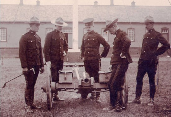 "Photograph of RNWMP members at Prince Alberta Post viewing their 7-pounder artillery piece (Source of photo - RCMP Historical Collection - ""Depot"" Division)."