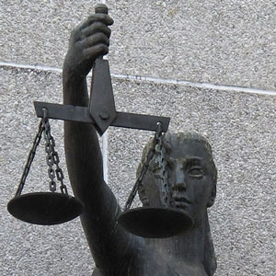 Photograph of the scale of justice statue at the New Westminster Court House (Source of photo - Sheldon Boles).