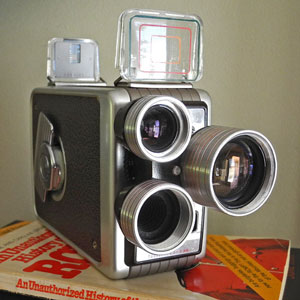 Photograph of old movie camera on RCMP book (Source of photo - Sheldon Boles).