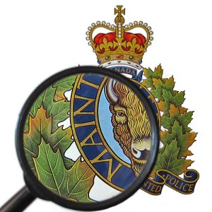 Photograph of RCMP crest with magnifying glass (Source of photo - Sheldon Boles).