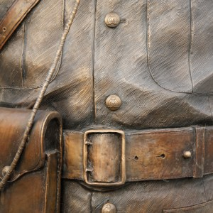 Photograph of RCMP uniform belt and serge in bronze (Source of photo - Sheldon Boles).