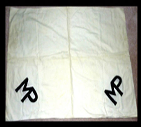 Photograph of the white sheet with the fused 'MP' (Source of photo - Ric Hall's Photo Collection).