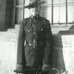 Photograph of Constable Douglas Marshall with his riding crop.