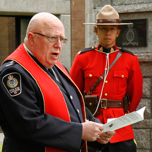 Photograph of RCMP Chaplain Jim Turner at Burnaby Detachment's memorial service (Source of photo - Sheldon Boles).