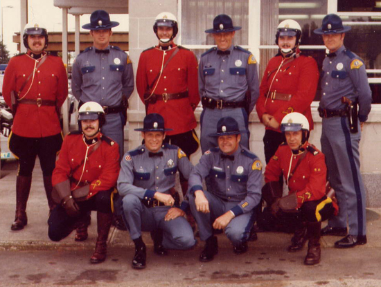 Late 1970s - Photograph of Surrey RCMP Traffic members photographed with members of the Washington State Patrol (Source of photo - Ric Hall's Photo Collection).