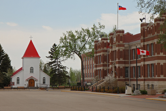 "Photograph of the RCMP ""Depot"" Square with ""A"" Block on the right and the Chapel in the background."