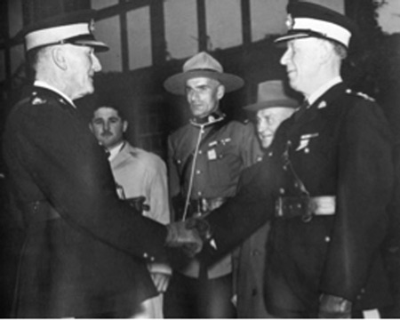 1946 - Photograph of another handshake, in the background, in uniform is Cpl. G.W. Peters, to his left 73 year old S/Cst. R.T. Johnson and on his right C/Cst. W.M. Cashin (Source of photo - Ric Hall's Photo Collection).