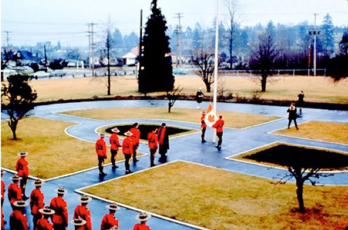 1965 - Photograph at the RCMP Fairmount Barracks in Vancouver - raising the new Canadian flag (Source of photo - Ric Hall's Photo Collection).