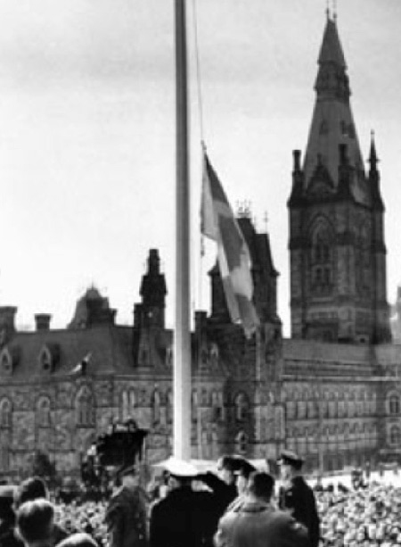 1965 - First raising of the Canadian Flag at the Canadian Parliament Buildings (Source of photo - Ric Hall's Photo Collection).