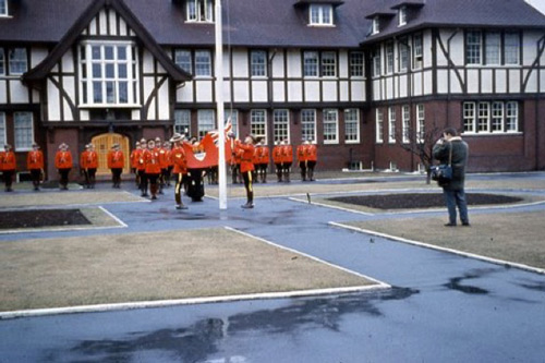 1965 - Photograph at the RCMP Fairmount Barracks in Vancouver - Red ensign coming down (Source of photo - Ric Hall's Photo Collection).