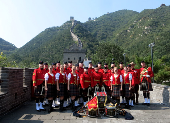 "Photograph of the ""E"" Division Pipe and Drum Band at the Great Wall of China (Source of photo - Mike"