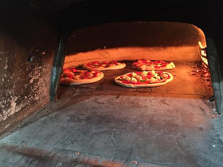 Pizzas in the oven on Baked on Board.