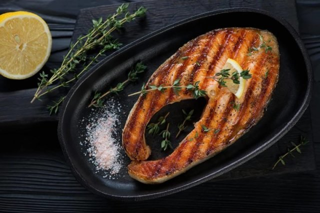 Salmon  Thes are Foods that can give you a body Odour 03 Fish Foods that Could Secretly Be Giving You Body Odor 561323797 Nickola Che 760x506