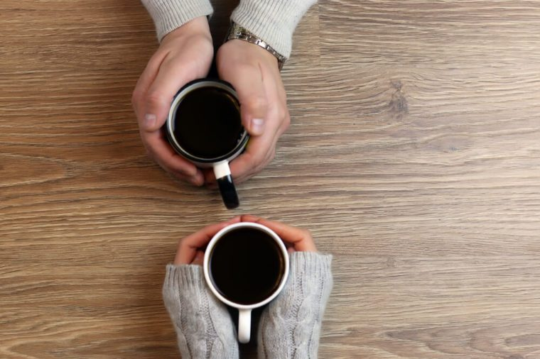 hand coffee background couple