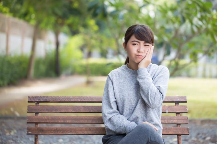 Woman has toothache coppy space