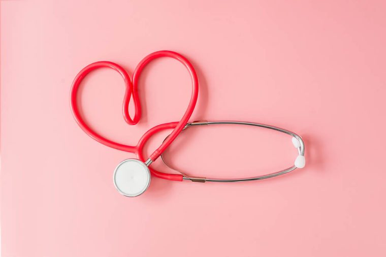 Red Stethoscope in Shape of Heart Isolated On