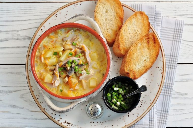 Cheese soup with mushrooms, chicken, potatoes and carrots.