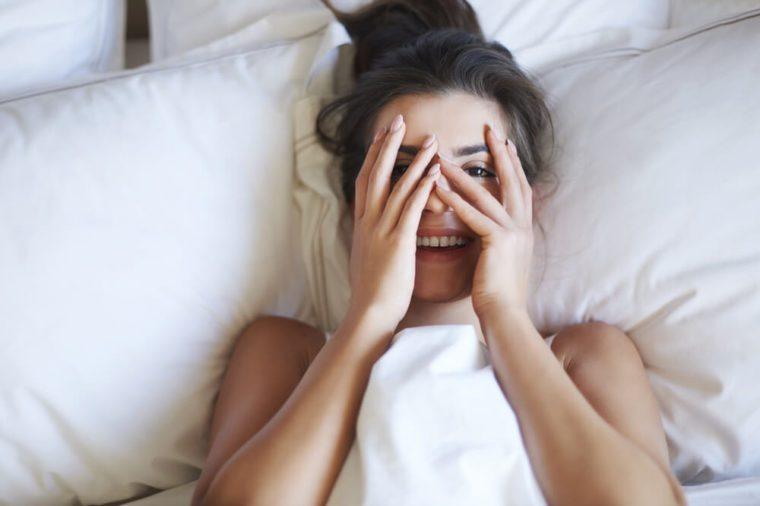She is little shy woman in bed