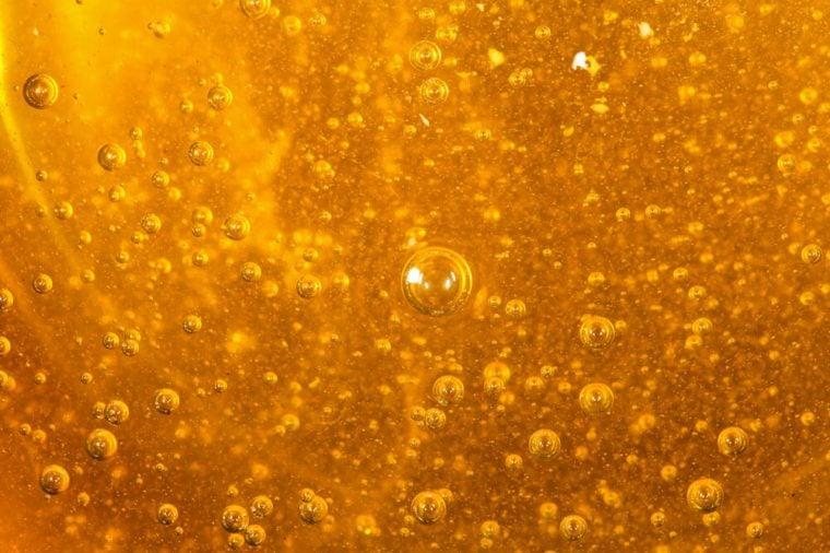 Close up photo of golden colored acacia honey