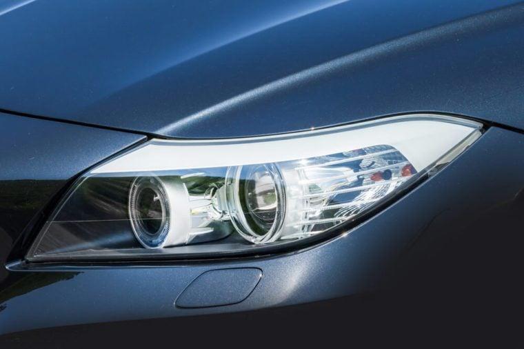 Headlight of the dark blue car