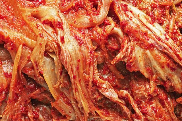close up of rustic korean fermented cabbage kimchi food background