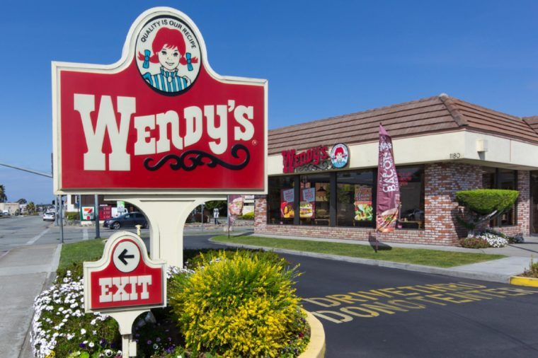 SEASIDE, CA/USA - MARCH 27, 2014: Wendy's fast food restaurant exterior and sign. Wendy's is the world's third largest hamburger fast food chain with approximately 6,650 locations.