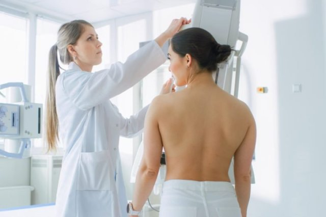 In the Hospital, Female Patients Undergoes Mammogram Screening Procedure Done by Mammography Technologist. Modern Technologically Advanced Clinic with Professional Doctors.