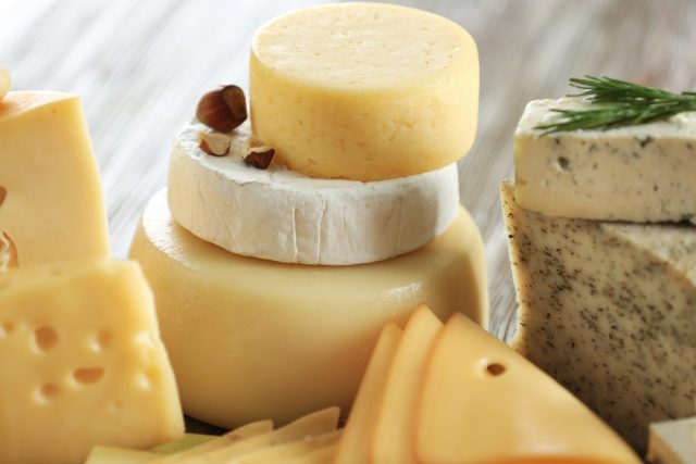 Variety of cheese on table