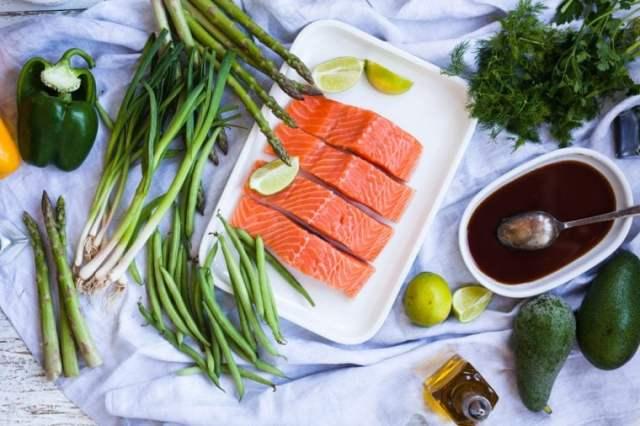 Cooking ingredients salmon fish and veggies ready for baking meal Fresh salmon ready for baking
