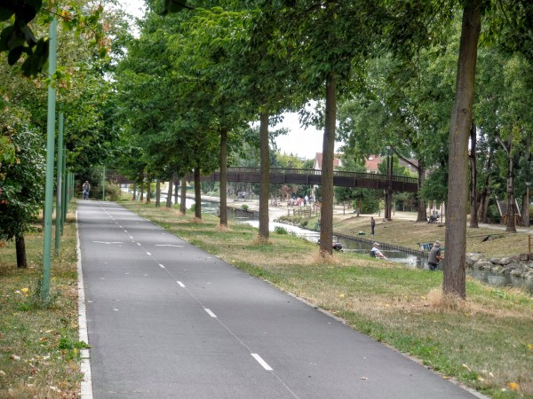 Bike path along a canal going from CDG airport to Paris