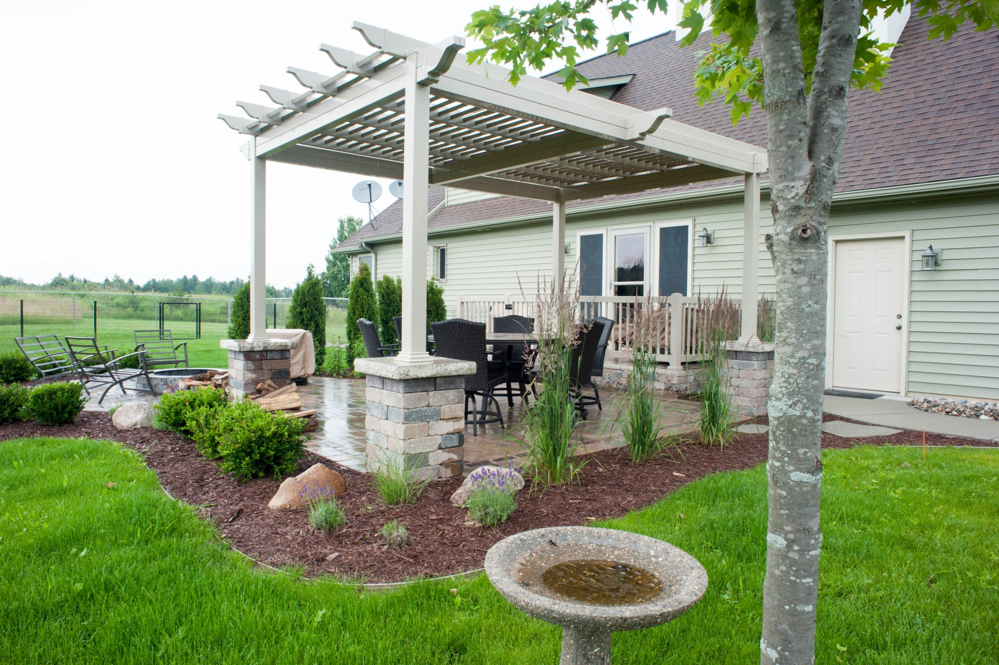 pergola over paver patio with fire pit
