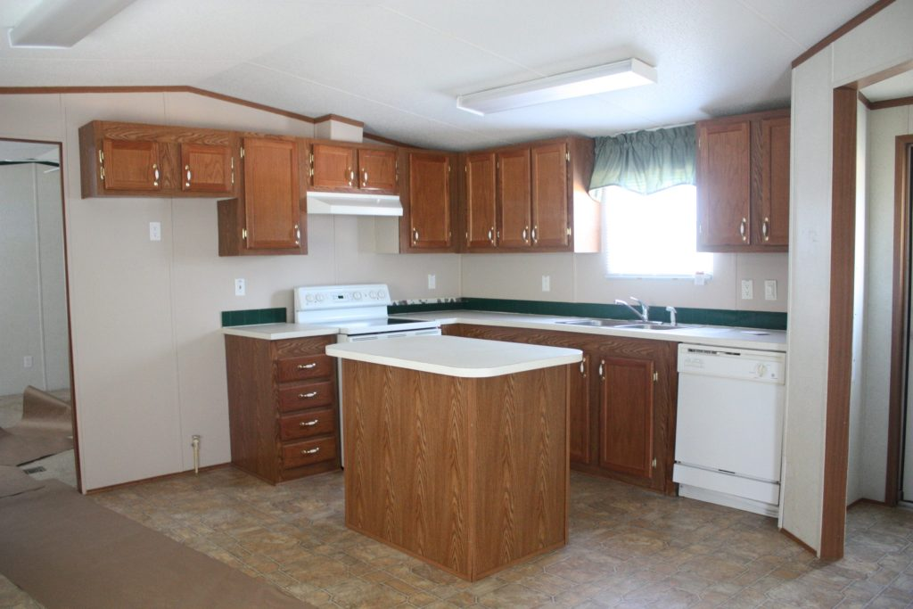 This mobile home kitchen needed major updating, and boy did it get it! Check out the post for how it was transformed {and how the backsplash was only $40}