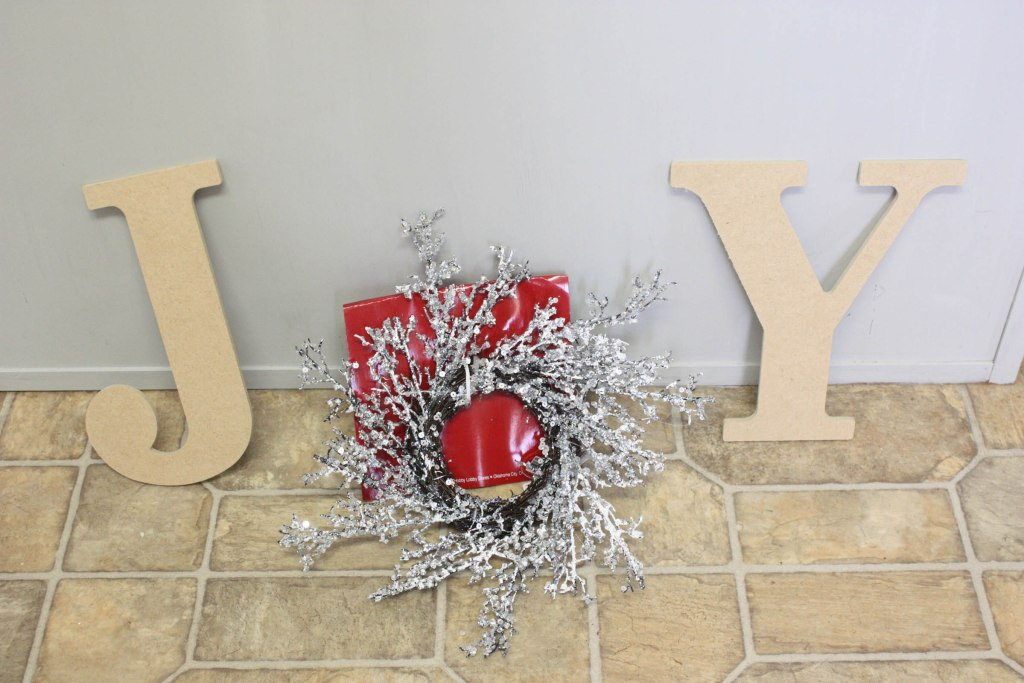 Taking Hobby Lobby letters and a small sparkly wreath to make a JOY sign!