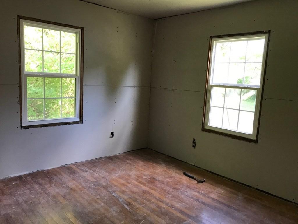 Bedroom progress at the Cottage Charmer! Sheet rock up!