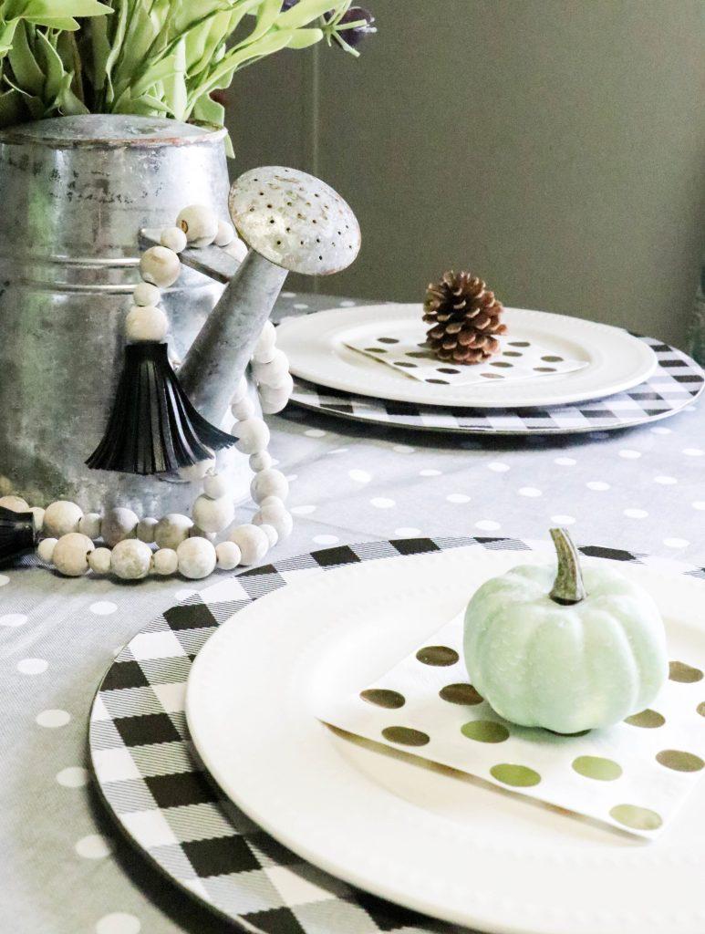 mini fall tablescape setting on a table