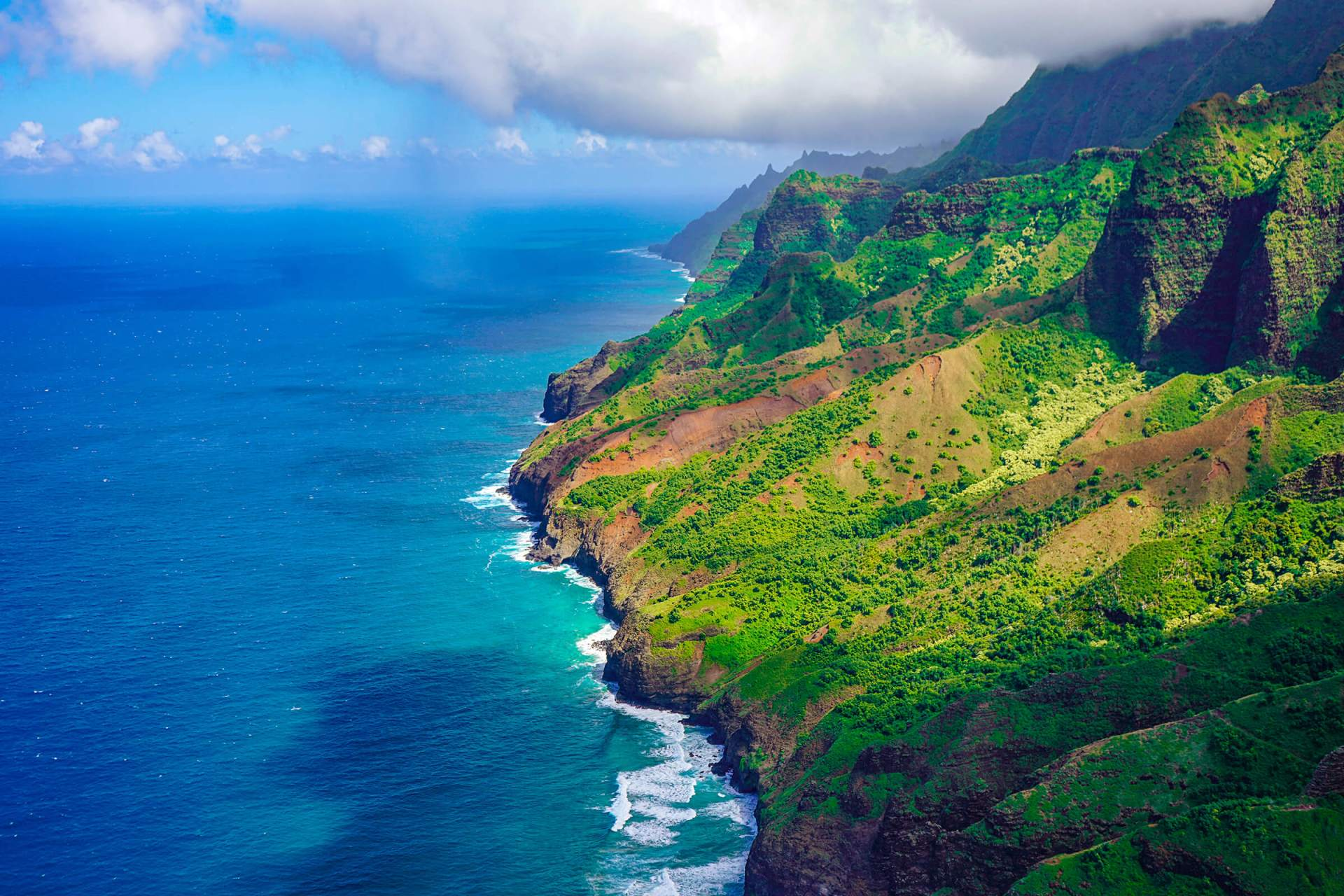React104 flies over the Nā Pali coast on the island of Kauai.