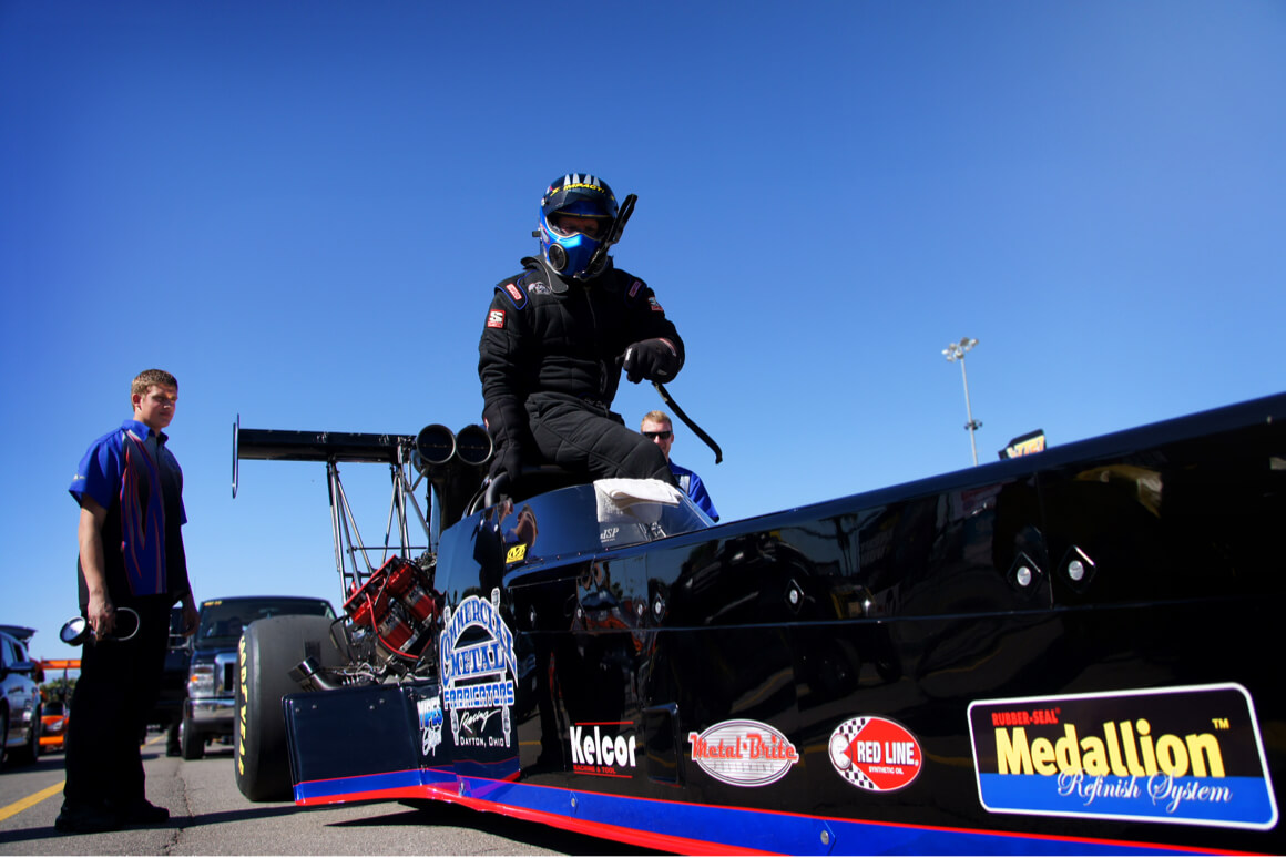 Pat Dakin climbs into his 11,000 horsepower Top Fuel Dragster.