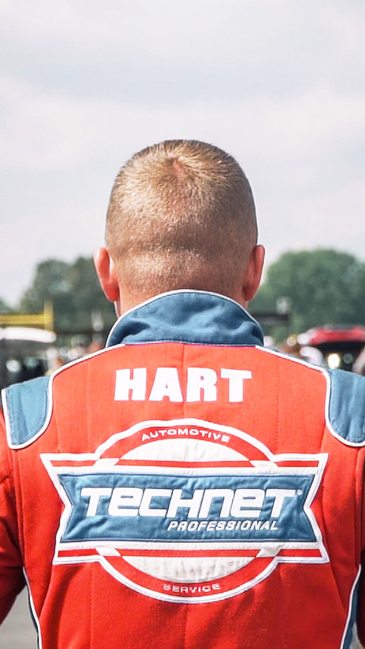 Josh Hart walks confidently through the staging lanes at the 2019 NHRA U.S. Nationals.
