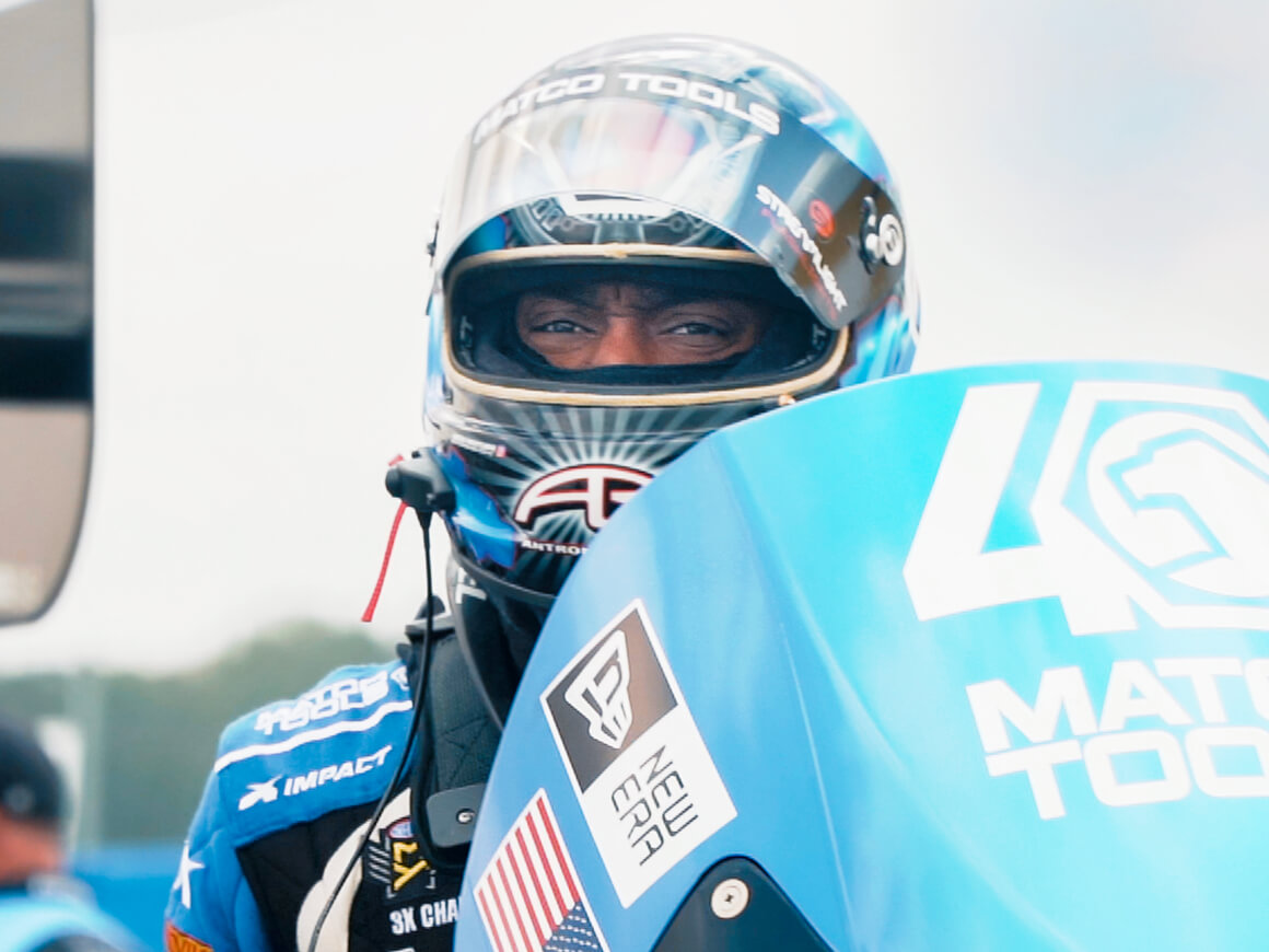Antron Brown climbs into his Matco Tools NHRA Top Fuel Dragster prior to the first round of eliminations at the 2019 NHRA U.S. Nationals.