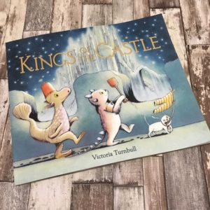 Kings of the castle by Victoria Turnbull on wood background